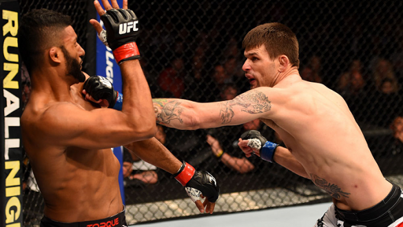 LOS ANGELES, CA - FEBRUARY 28:  (R) Tim Means punches Dhiego Lima in their welterweight bout during the UFC 184 event at Staples Center on February 28, 2015 in Los Angeles, California.  (Photo by Josh Hedges/Zuffa LLC/Zuffa LLC via Getty Images)