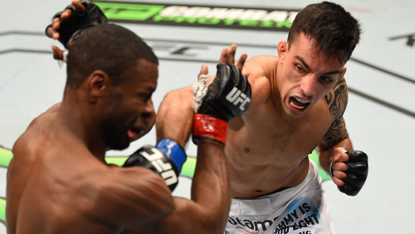 MONTREAL, QC - APRIL 25:   (R-L) Thomas Almeida of Brazil punches Yves Jabouin of Canada in their bantamweight bout during the UFC 186 event at the Bell Centre on April 25, 2015 in Montreal, Quebec, Canada. (Photo by Josh Hedges/Zuffa LLC/Zuffa LLC via Ge