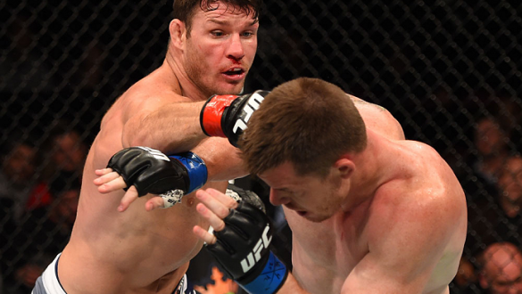 MONTREAL, QC - APRIL 25:   (L-R) Michael Bisping of England punches CB Dollaway of the United States in their middleweight bout during the UFC 186 event at the Bell Centre on April 25, 2015 in Montreal, Quebec, Canada. (Photo by Josh Hedges/Zuffa LLC/Zuff