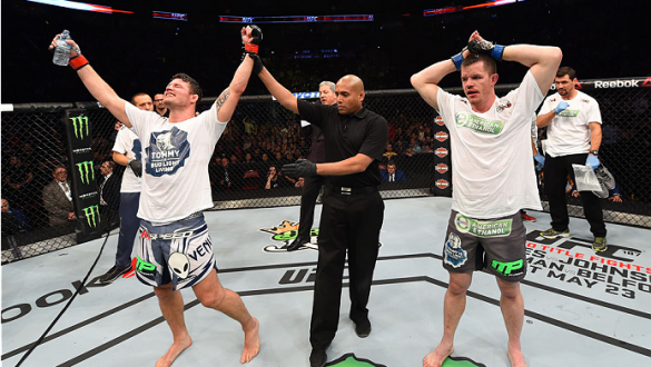 MONTREAL, QC - APRIL 25:   Michael Bisping (L) of England celebrates after his decision victory over CB Dollaway of the United States in their middleweight bout during the UFC 186 event at the Bell Centre on April 25, 2015 in Montreal, Quebec, Canada. (Ph