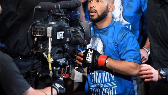 MONTREAL, QC - APRIL 25:   Demetrious Johnson of the United States enters the arena before his UFC flyweight championship bout against Kyoji Horiguchi during the UFC 186 event at the Bell Centre on April 25, 2015 in Montreal, Quebec, Canada. (Photo by Jos