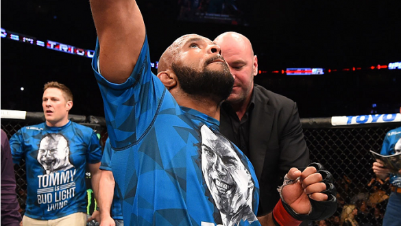 MONTREAL, QC - APRIL 25:   Demetrious Johnson of the United States reacts after his submission victory over Kyoji Horiguchi of Japan in their UFC flyweight championship bout during the UFC 186 event at the Bell Centre on April 25, 2015 in Montreal, Quebec
