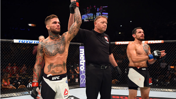 LAS VEGAS, NV - JULY 11:  Cody Garbrandt (left) reacts to his victory over Henry Briones (right) in their bantamweight fight during the UFC 189 event inside MGM Grand Garden Arena on July 11, 2015 in Las Vegas, Nevada.  (Photo by Josh Hedges/Zuffa LLC/Zuf