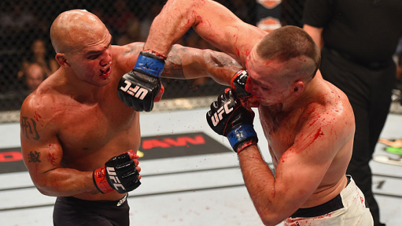 LAS VEGAS, NV - JULY 11:  (L-R) Robbie Lawler punches Rory MacDonald in their UFC welterweight title fight during the UFC 189 event inside MGM Grand Garden Arena on July 11, 2015 in Las Vegas, Nevada.  (Photo by Josh Hedges/Zuffa LLC/Zuffa LLC via Getty I