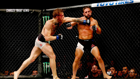 LAS VEGAS, NV - JULY 11:  (L-R) Conor McGregor punches Chad Mendes in their UFC interim featherweight title fight during the UFC 189 event inside MGM Grand Garden Arena on July 11, 2015 in Las Vegas, Nevada.  (Photo by Christian Petersen/Zuffa LLC/Zuffa L