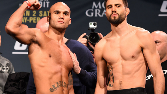 LAS VEGAS, NV - JANUARY 01:   (L-R) UFC welterweight champion Robbie Lawler and opponent Carlos Condit pose for photos during the UFC 195 weigh-in at the MGM Grand Conference Center on January 1, 2016 in Las Vegas, Nevada. (Photo by Josh Hedges/Zuffa LLC/