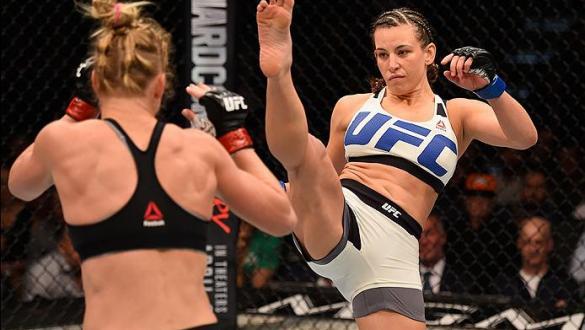 LAS VEGAS, NV - MARCH 05: (R-L) Miesha Tate kicks Holly Holm in their UFC women's bantamweight championship bout during the UFC 196 event inside MGM Grand Garden Arena on March 5, 2016 in Las Vegas, Nevada.  (Photo by Josh Hedges/Zuffa LLC/Zuffa LLC via G