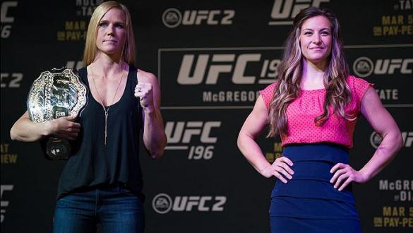 LAS VEGAS, NV - MARCH 3:   (L-R) UFC bantamweight champion Holly Holm and Miesha Tate pose for the media during the UFC 196 Press Conference at David Copperfield Theater in the MGM Grand Hotel/Casino on March 3, 2016 in Las Vegas, Nevada. (Photo by Brando
