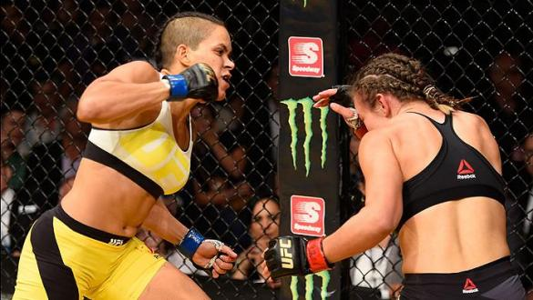 LAS VEGAS, NV - JULY 09: (L-R) Amanda Nunes of Brazil punches Miesha Tate in their UFC women's bantamweight championship bout during the UFC 200 event on July 9, 2016 at T-Mobile Arena in Las Vegas, Nevada.  (Photo by Josh Hedges/Zuffa LLC/Zuffa LLC via G