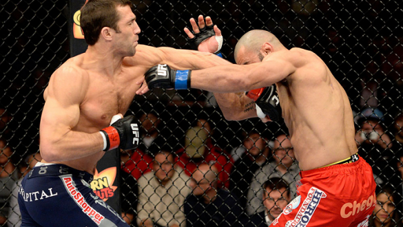DULUTH, GA - JANUARY 15: (L-R) Luke Rockhold punches Costas Philippou in their middleweight fight during the UFC Fight Night event inside The Arena at Gwinnett Center on January 15, 2014 in Duluth, Georgia. (Photo by Jeff Bottari/Zuffa LLC/Zuffa LLC via G