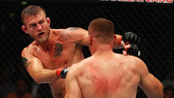 HAMBURG, GERMANY - SEPTEMBER 03:  Alexander Gustafsson (L) of Sweden punches Jan Blachowicz (R) of Poland compete in their Light Heavyweight Bout during the UFC Fight Night held at Barclaycard Arena on September 3, 2016 in Hamburg, Germany.  (Photo by Dea