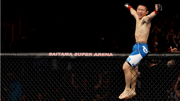 SAITAMA, JAPAN - SEPTEMBER 20: Kyoji Horiguchi celebrates his win over  Jon Delos Reyes in their flyweight bout during the UFC Fight Night event inside the Saitama Arena on September 20, 2014 in Saitama, Japan. (Photo by Mitch Viquez/Zuffa LLC/Zuffa LLC v
