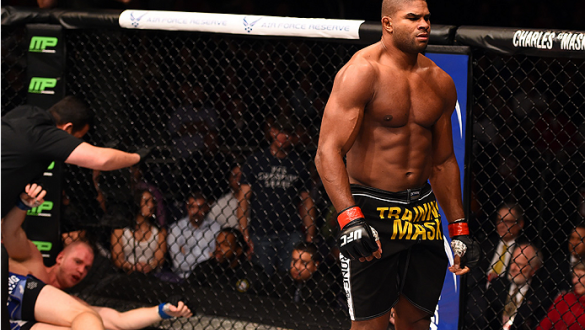 PHOENIX, AZ - DECEMBER 13:  (R-L) Alistair Overeem of the Netherlands walks away from Stefan Struve of the Netherlands after defeating him in their heavyweight fight during the UFC Fight Night event at the U.S. Airways Center on December 13, 2014