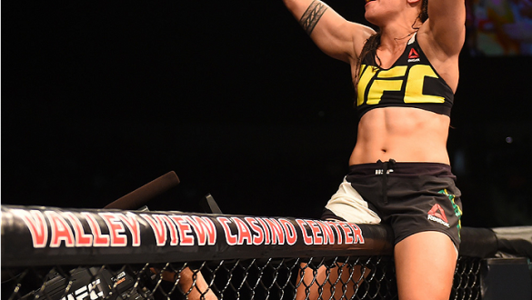 SAN DIEGO, CA - JULY 15:   Jessica Andrade of Brazil celebrates her victory over Sarah Moras of Canada in their women's bantamweight bout during the UFC event at the Valley View Casino Center on July 15, 2015 in San Diego, California. (Photo by Jeff Botta
