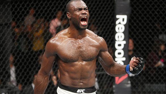 SAITAMA, JAPAN - SEPTEMBER 27:  Uriah Hall of Jamaica celebrates his win over Gegard Mousaasi of Iran in their middleweight bout during the UFC event at the Saitama Super Arena on September 27, 2015 in Saitama, Japan. (Photo by Mitch Viquez/Zuffa LLC/Zuff