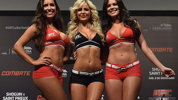 UBERLANDIA, BRAZIL - NOVEMBER 07:  (L-R) UFC Octagon Girls Luciana Andrade, Jhenny Andrade and Camila Oliveira stand on stage during the UFC Fight Night weigh-in at Sabiazinho Gymnasium on November 7, 2014 in Uberlandia, Brazil.  (Photo by Buda Mendes/Zuf