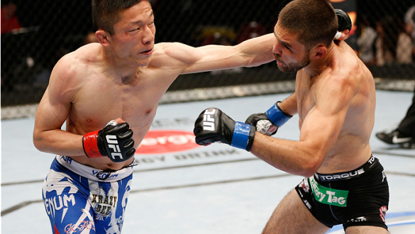 CINCINNATI, OH - MAY 10:  (L-R) Kyoji Horiguchi punches Darrell Montague in their flyweight fight during the UFC Fight Night event at the U.S. Bank Arena on May 10, 2014 in Cincinnati, Ohio. (Photo by Josh Hedges/Zuffa LLC/Zuffa LLC via Getty Images)