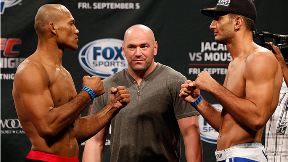 """MASHANTUCKET, CT - SEPTEMBER 04:  (L-R) Opponents Ronaldo """"Jacare"""" Souza of Brazil and Gegard Mousasi of The Netherlands face off during the UFC Fight Night weigh-in at Foxwoods Resort Casino on September 4, 2014 in Mashantucket, Connecticut.  (Photo by J"""