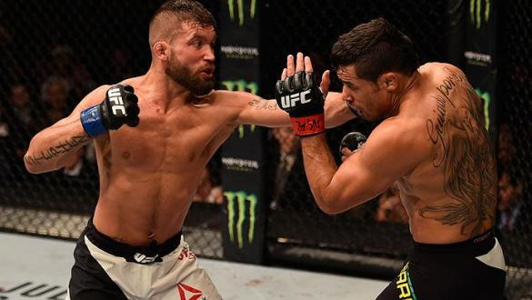 LAS VEGAS, NV - MAY 29: (L-R) Jeremy Stephens punches Renan Barao of Brazil in their featherweight bout during the UFC Fight Night event inside the Mandalay Bay Events Center on May 29, 2016 in Las Vegas, Nevada.  (Photo by Josh Hedges/Zuffa LLC/Zuffa LLC