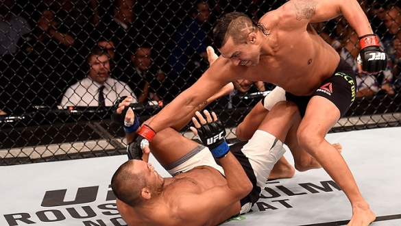 SAO PAULO, BRAZIL - NOVEMBER 07:  Vitor Belfort of Brazil punches Dan Henderson of the United States in their middleweight bout during the UFC Fight Night Belfort v Henderson on November 7, 2015 in Sao Paulo, Brazil.  (Photo by Buda Mendes/Zuffa LLC/Zuffa