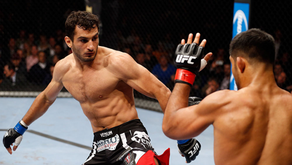 BERLIN, GERMANY - MAY 31:  Gegard Mousasi (L) fights Mark Munoz during the Gegard Mousasi vs. Mark Munoz match at UFC Fight Night Berlin event at O2 World on May 31, 2014 in Berlin, Germany. (Photo by Boris Streubel/Zuffa LLC/Zuffa LLC via Getty Images)