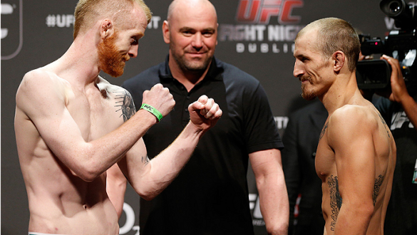 DUBLIN, IRELAND - JULY 18:  (L-R) Opponents Patrick Holohan and Josh Sampo face off during the UFC weigh-in event at The O2 on July 18, 2014 in Dublin, Ireland.  (Photo by Josh Hedges/Zuffa LLC/Zuffa LLC via Getty Images)