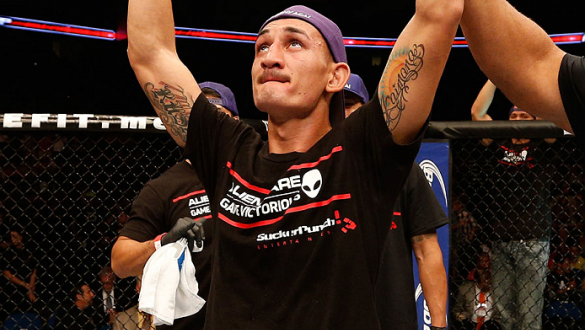 TULSA, OK - AUGUST 23:  Max Holloway celebrates after his victory over Clay Collard in their featherweight fight during the UFC Fight Night event at the BOK Center on August 23, 2014 in Tulsa, Oklahoma. (Photo by Josh Hedges/Zuffa LLC/Zuffa LLC via Getty