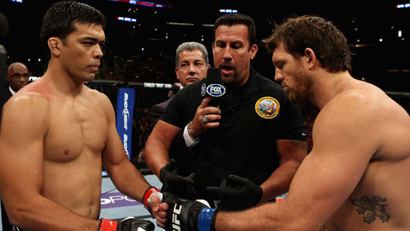 LOS ANGELES, CA - AUGUST 04:  Lyoto Machida (L) pumps fists with Ryan Bader (R) before their light heavyweight bout during the UFC on FOX at Staples Center on August 4, 2012 in Los Angeles, California. Machida won the bout by way of knock out in the secon