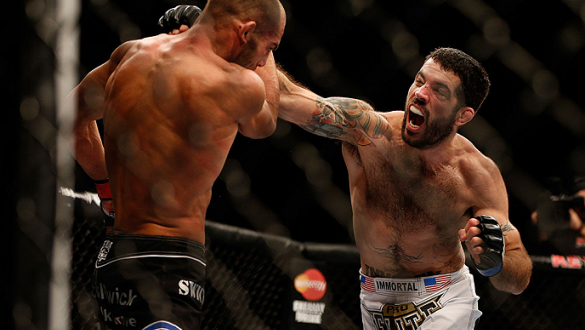 SEATTLE, WA - DECEMBER 08:  (R-L) Matt Brown punches Mike Swick during their welterweight bout at the UFC on FOX event on December 8, 2012  at Key Arena in Seattle, Washington.  (Photo by Ezra Shaw/Zuffa LLC/Zuffa LLC via Getty Images) *** Local Caption *
