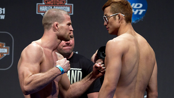 MILWAUKEE, WI - AUGUST 30:  (L-R) Pascal Krauss and Hyun Gyu Lim face off during the UFC 164 weigh-in inside the BMO Harris Bradley Center on August 30, 2013 in Milwaukee, Wisconsin. (Photo by Ed Mulholland/Zuffa LLC/Zuffa LLC via Getty Images) *** Local