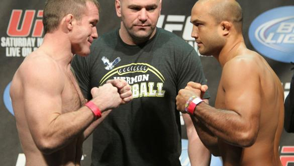 Welterweight opponents Matt Hughes (L) and BJ Penn (R) face off as UFC President Dana White looks on at the UFC 123 weigh-in at the Palace of Auburn Hills on November 19, 2010 in Auburn Hills, Michigan.  (Photo by Josh Hedges/Zuffa LLC/Zuffa LLC via Getty