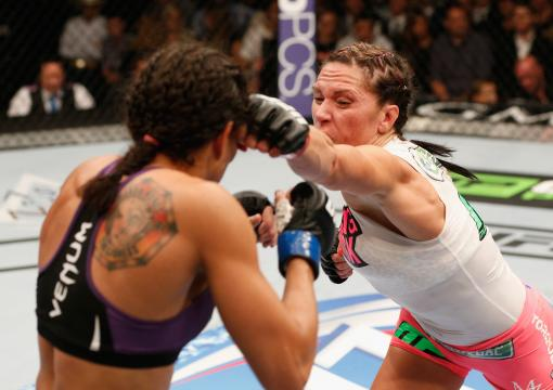 Cat Zingano fights Amanda Nunes in their women's bantamweight fight during the UFC 178 event inside the MGM Grand Garden Arena on September 27, 2014 in Las Vegas, Nevada.