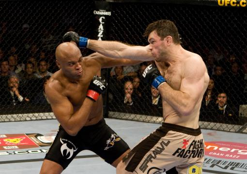 Anderson Silva (black/yellow shorts) def. Forrest Griffin (tan shorts) - KO - 3:23 round 1 during UFC 101 at Wachovia Center on August 8, 2009 in Philadelphia, Pennsylvania. (Photo by Josh Hedges/Zuffa LLC via Getty Images)