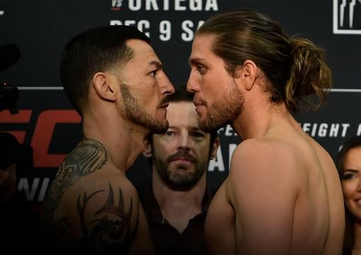 FRESNO, CA - DECEMBER 08: (L-R) Opponents Cub Swanson and Brian Ortega face off during the UFC Fight Night weigh-in inside Valdez Hall on December 8, 2017 in Fresno, California. (Photo by Jeff Bottari/Zuffa LLC/Zuffa LLC via Getty Images)