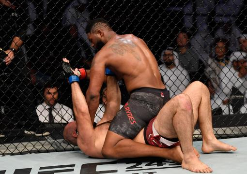 Curtis Blaydes (top) punches Shamil Abdurakhimov of Russia in their heavyweight bout during UFC 242 at The Arena on September 7, 2019 in Yas Island, Abu Dhabi, United Arab Emirates. (Photo by Jeff Bottari/Zuffa LLC)
