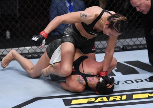 Antonina Shevchenko of Kyrgyzstan (top) punches Ariane Lipski of Brazil in their women's flyweight bout during the UFC 255 event at UFC APEX on November 21, 2020 in Las Vegas, Nevada. (Photo by Jeff Bottari/Zuffa LLC)