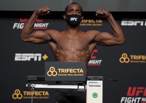 Geoff Neal poses on the scale during the UFC Fight Night weigh-in at UFC APEX on December 18, 2020 in Las Vegas, Nevada. (Photo by Cooper Neill/Zuffa LLC via Getty Images)