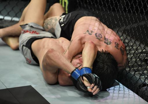 Ricky Simon secures an arm triangle choke against Gaetano Pirrello of Belgium in a bantamweight fight during the UFC Fight Night event at Etihad Arena on UFC Fight Island on January 20, 2021 in Abu Dhabi, United Arab Emirates. (Photo by Jeff Bottari/Zuffa LLC)