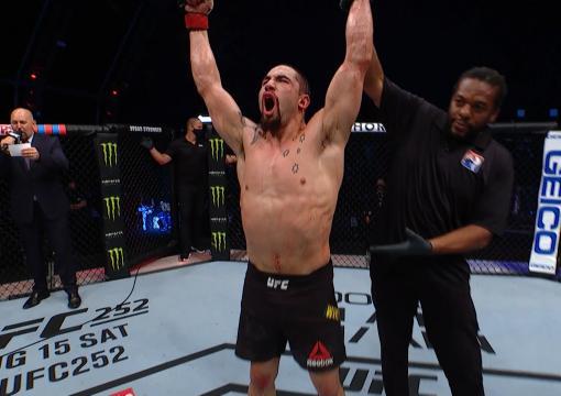 Robert Whittaker celebrates after defeating Darren Till on UFC Fight Island 2020