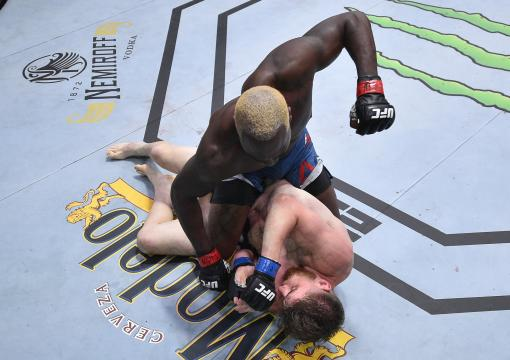 Derek Brunson punches Edmen Shahbazyan in their middleweight fight during the UFC Fight Night event at UFC APEX on August 01, 2020 in Las Vegas, Nevada. (Photo by Chris Unger/Zuffa LLC)