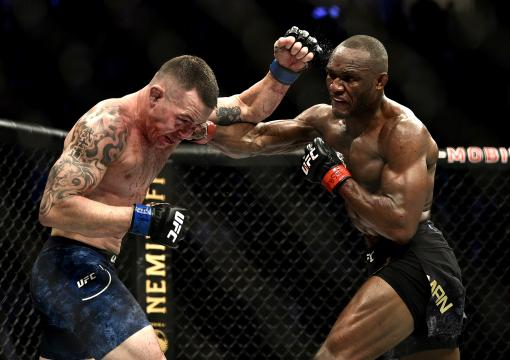 Kamaru Usman of Nigeria punches Colby Covington in their UFC welterweight championship bout during the UFC 245 event at T-Mobile Arena on December 14, 2019 in Las Vegas, Nevada. (Photo by Chris Unger/Zuffa LLC)