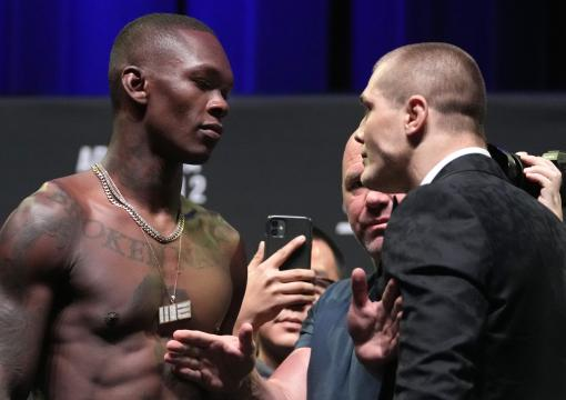 Israel Adesanya of Nigeria and Marvin Vettori of Italy face off during the UFC 263 press conference at Arizona Federal Theater on June 10, 2021 in Phoenix, Arizona. (Photo by Jeff Bottari/Zuffa LLC)