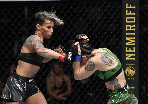 manda Lemos of Brazil punches Montserrat Conejo of Mexico in their strawweight bout during the UFC Fight Night event at UFC APEX on July 17, 2021 in Las Vegas, Nevada. (Photo by Jeff Bottari/Zuffa LLC)