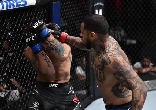 Daniel Rodriguez punches Preston Parsons in their welterweight bout during the UFC Fight Night event at UFC APEX on July 17, 2021 in Las Vegas, Nevada. (Photo by Jeff Bottari/Zuffa LLC)