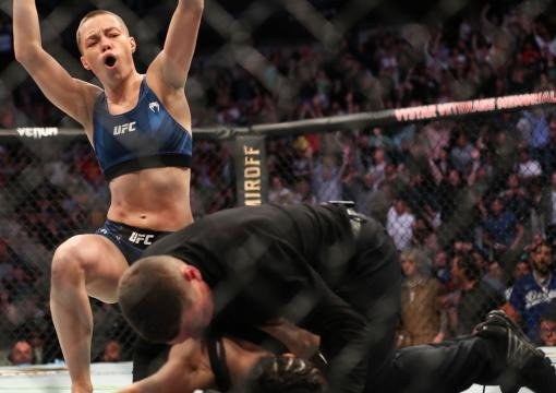 Rose Namajunas of the United States celebrates after beating Zhang Weili of China during the Women's Strawweight Title bout of UFC 261 at VyStar Veterans Memorial Arena on April 24 2021 in Jacksonville Florida (Photo by Alex Menendez/Getty Images)