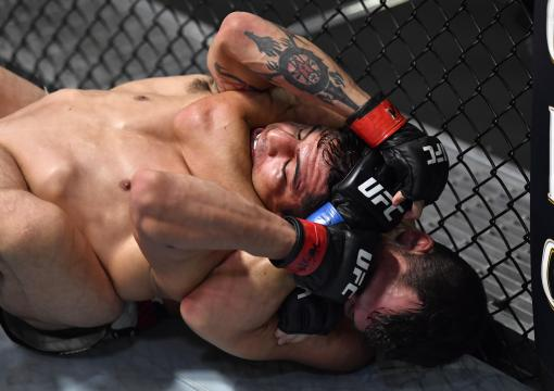 Billy Quarantillo attempts to secure a rear choke against Gabriel Benitez of Mexico in their featherweight bout during the UFC Fight Night event at UFC APEX on July 17, 2021 in Las Vegas, Nevada. (Photo by Jeff Bottari/Zuffa LLC)