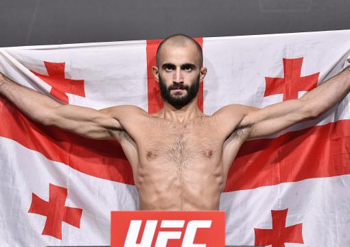 Giga Chikadze of Georgia poses on the scale during the UFC Fight Night weigh-in at UFC APEX on August 27 2021 in Las Vegas Nevada. (Photo by Chris Unger/Zuffa LLC)