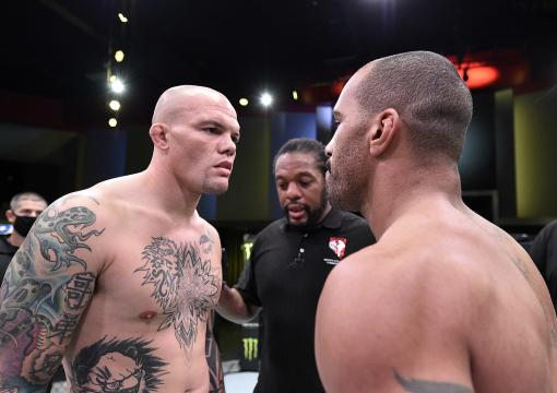 Anthony Smith and Devin Clark face off and touch gloves prior to their light heavyweight bout during the UFC Fight Night at UFC APEX on November 28 2020 in Las Vegas Nevada (Photo by Chris Unger/Zuffa LLC)
