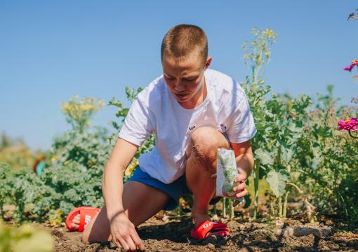 Rose Namajunas tends to her garden at Rose Roots Community Garden in Arvada, Colorado, on August 25, 2021. (Photo by Zac Pacleb)