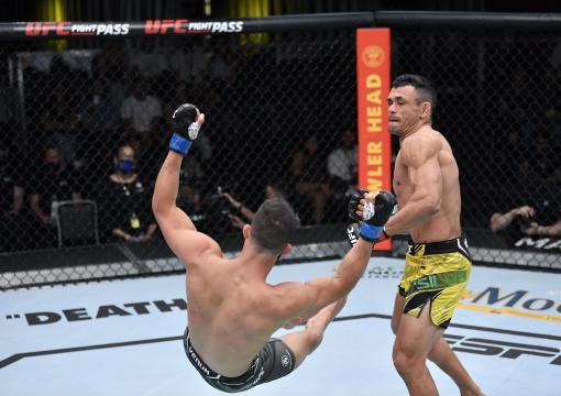 Douglas Silva de Andrade of Brazil knocks down Gaetano Pirrello of Belgium in their bantamweight bout during the UFC Fight Night event at UFC APEX on October 02 2021 in Las Vegas Nevada. (Photo by Jeff Bottari/Zuffa LLC)
